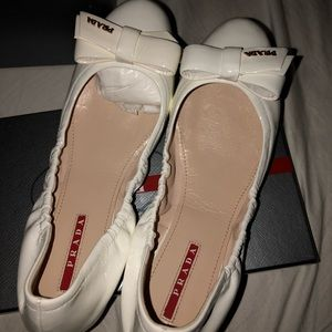 White Prada slippers in new condition